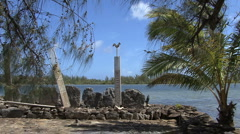 Huahine sacred site with bird and palm Stock Footage