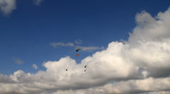 Helicopters with flags flying in the blue sky on national holiday Stock Footage