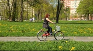 Stock Video Footage of Close up tracking shot of the woman on the bicycle