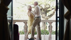 Senior married couple dancing outdoor - stock footage