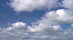 Fast time lapse clouds against blue sky Stock Footage