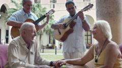 Seniors drinking in hotel bar during serenade Stock Footage