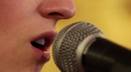 Woman singing into microphone on stage Dolly Shot Stock Footage