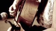 Woman playing guitar handheld Stock Footage