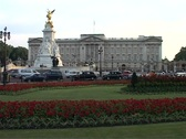 Stock Video Footage of Pan across Buckingham Palace, London England GFSD