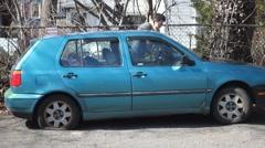 bad car, flat tire w - stock footage