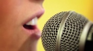 Girl singing into microphone on stage Stock Footage