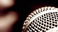 Closeup of Microphone and finger picking (Rack Focus) Stock Footage