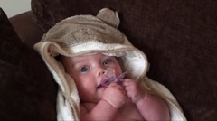 Baby girl, 5 months old, in bath towel Stock Footage