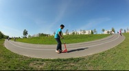 Stock Video Footage of Extreme wide angle view on the road turn in the park.