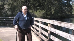 Senior Walking Along River 2 - stock footage