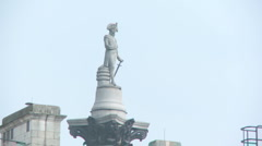 Statue of Lord Nelson on top of Nelsons Column 60i Stock Footage