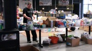 Stock Video Footage of People Preparing Supplies for Tornado Disaster Victims (HD) c
