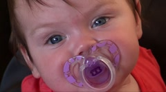 Baby girl 5 months dummy pacifier Stock Footage