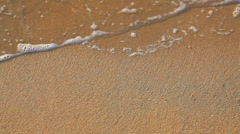 Wave and sand beach Stock Footage