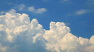 Stock Video Footage of Time lapse clip of white clouds over blue sky