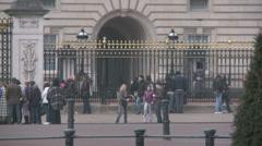 Tourists Outside Buckingham Palacee 60i - stock footage