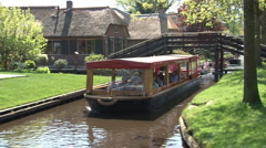 Boat tour on channel in Giethoorn Stock Footage