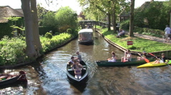 Boats on channel in Giethoorn Stock Footage