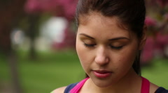 Pretty young woman smiling, closeup at the park Stock Footage