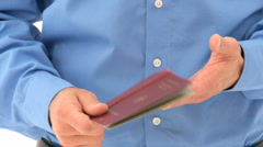Close up passport in the hands of a man Stock Footage