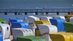 Beach chairs on sand strand, Foehr Island, North Sea, Germany Stock Footage