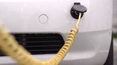 Electric Car Plugged In Charging Stock Footage