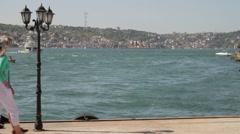 Couple walking on Promenade at the Bosphorus river Turkey, Istanbul Stock Footage