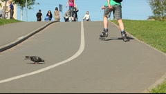 Inline skater ride up the road Stock Footage