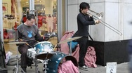 Street Musicians Playing at Toronto's Eaton Centre Sidewalk Stock Footage