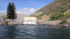 Sluice gates release flood water from dam Stock Footage