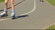 Stock Video Footage of Inline skater legs on the road slope