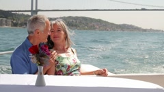 Senior couple embracing on a yacht in Istanbul, Turkey Stock Footage