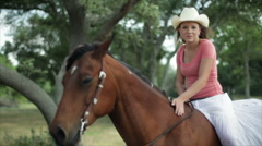 Girl on her horse Stock Footage