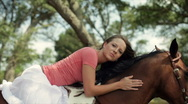 Stock Video Footage of girl laying on her horse