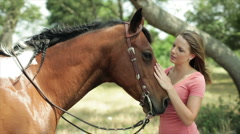 Girl petting her horse closeup Stock Footage