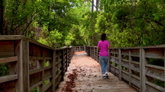 Woman walking in woods Stock Footage