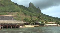 Moorea thatched building and peak on Cook's Bay Stock Footage