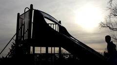 Shadow of kid waving on playground slide Stock Footage