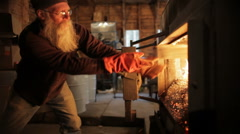 Adding Wood to Maple Sap Evaporator-Wide Shot - stock footage
