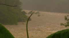 Raging flood Storm Torrential Rain Turbulent Mud Flood River Water w audio - stock footage