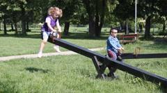 children fun on seesaw - stock footage