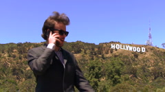 Hollywood agent with cell wide V1 - HD Stock Footage