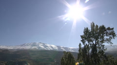Snowy mountains with sun Stock Footage