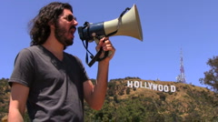 Movie director by Hollywood sign - HD Stock Footage