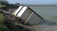 Eroded river bank and toilet block Stock Footage