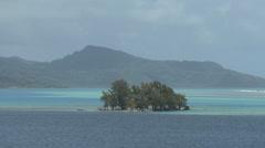 Raiatea zooms from island in lagoon Stock Footage