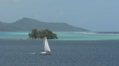 Raiatea sailboat in lagoon 2 - stock footage