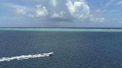 Raiatea speed boat inside reef Stock Footage