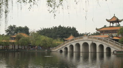 Stone arch bridge and Pavilion - panning Stock Footage